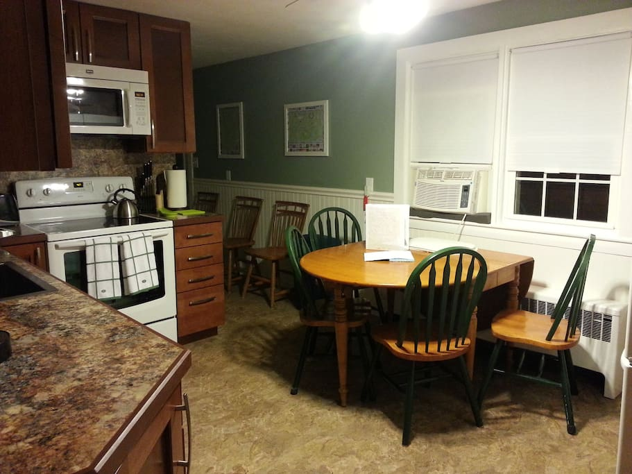 Updated eat in kitchen with new appliances.
