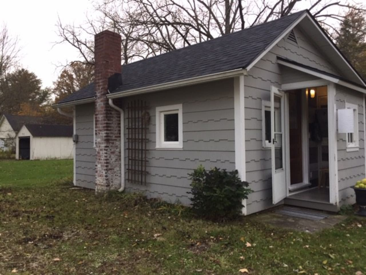 """The Cottage sits behind """"the big house"""", which has the listing's address of 54 N. Prospect St."""