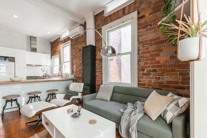 Light filled exposed brick Victorian cottage