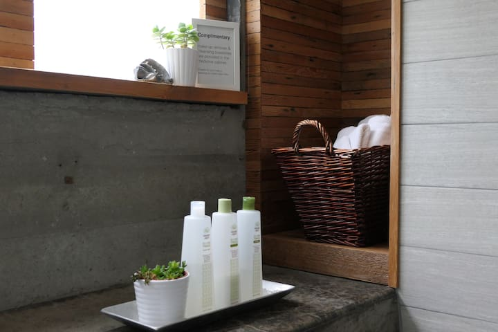 Reclaimed woodwork is a nice backdrop for plants, soaps + fresh towels.