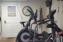 One exercise bike, two elypticals and one treadmill