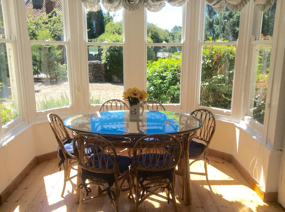 Sunny dining area in south facing bay window