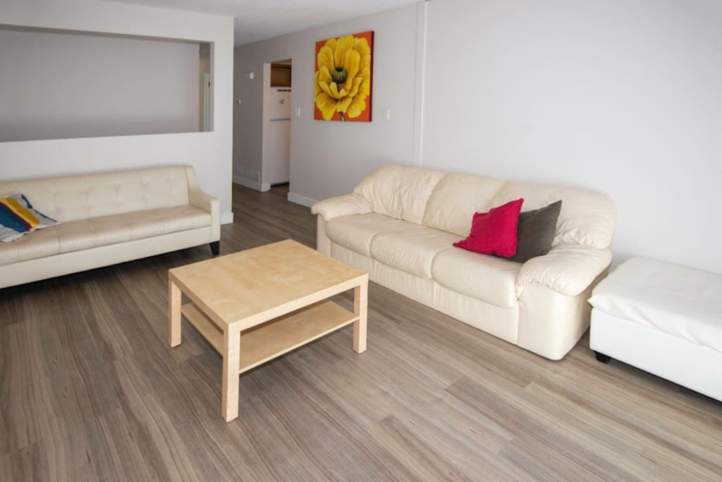 Bright living room with sunny front porch/deck #1