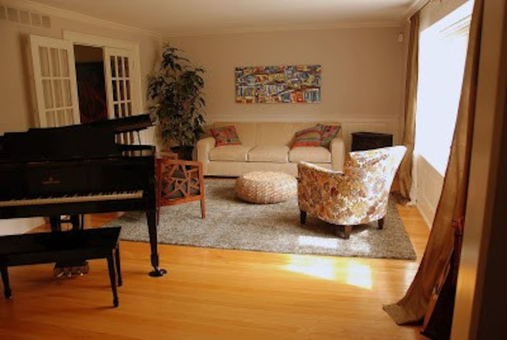 Beautiful front room with Steinway and plenty of natural light.