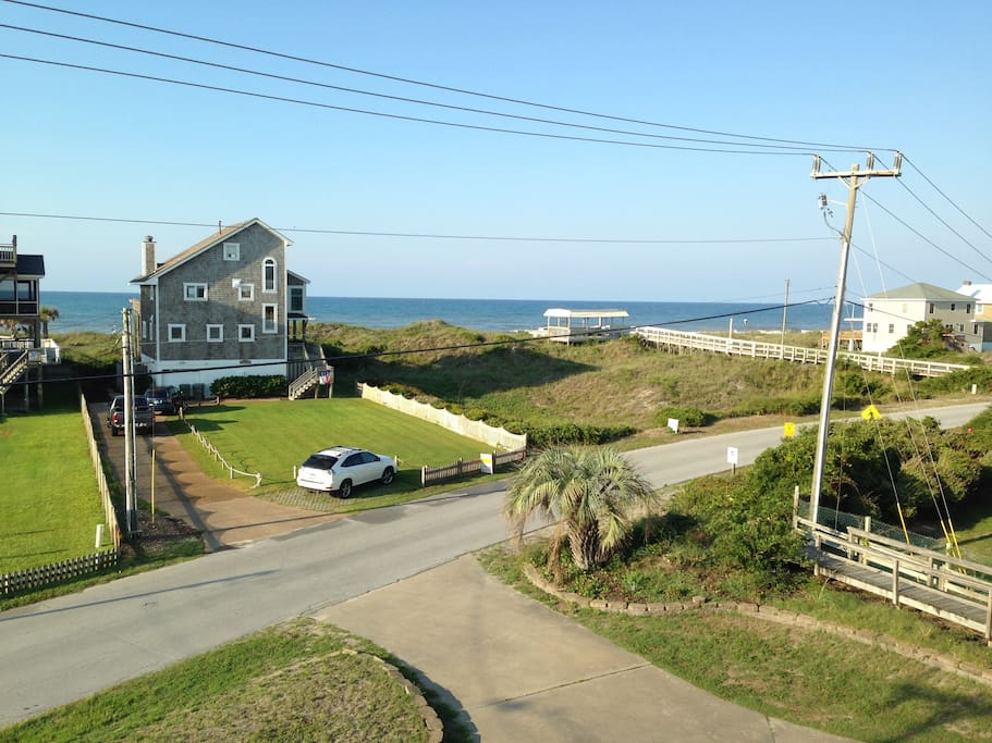Ocean view from the third floor terrace; beach access immediately to the right