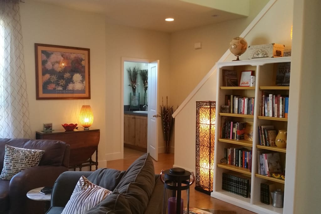 Living room, half bath, lots of books to read!