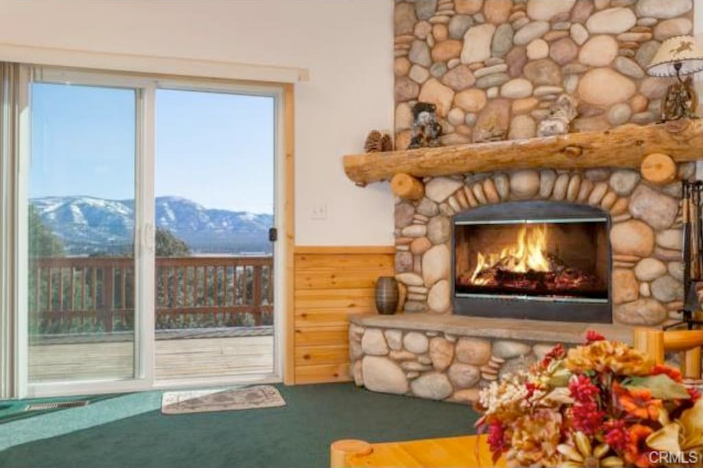 """Fireplace with deck 55"""" Flat Screen with Direct T.V and NFL Ticket for all games"""
