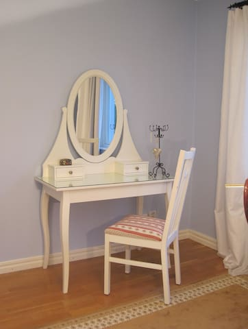 The bedroom is equipped with a beautiful dressing table