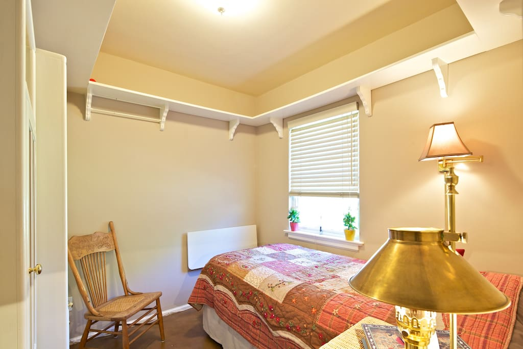 """The white """"board"""" at the foot of the bed is a fold-down desk.  Now a TV is also on that wall, see below pics."""