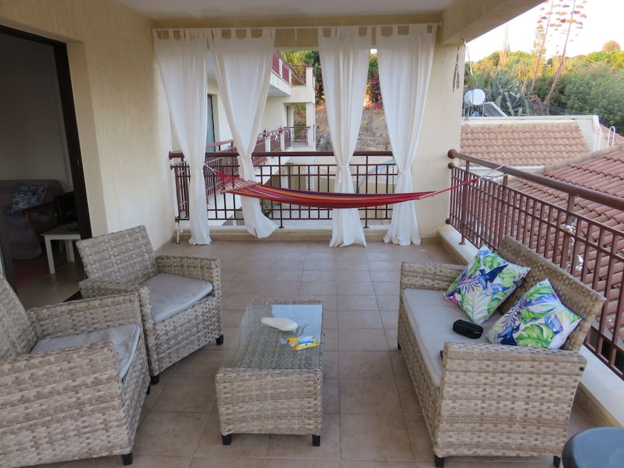 Excellent outside balcony space, seating and hammock for chilling