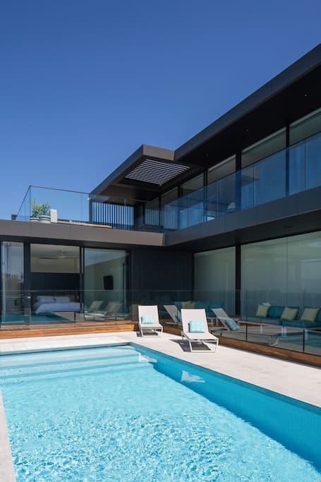 View of the heated pool, large upstairs terrace & master bedroom