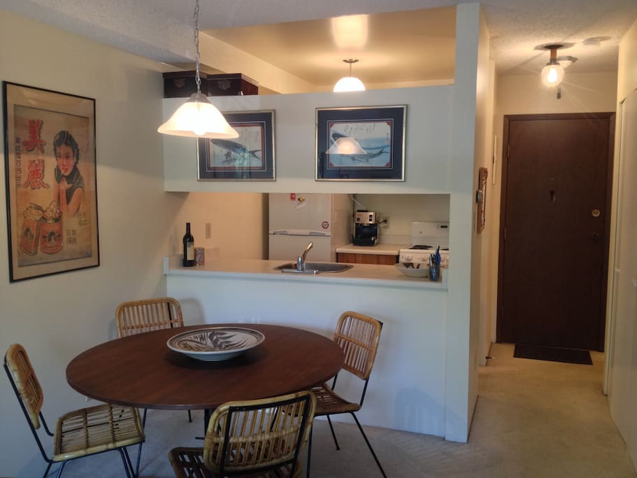 Full service kitchen with large table for eating the few at home meals you'll cook!
