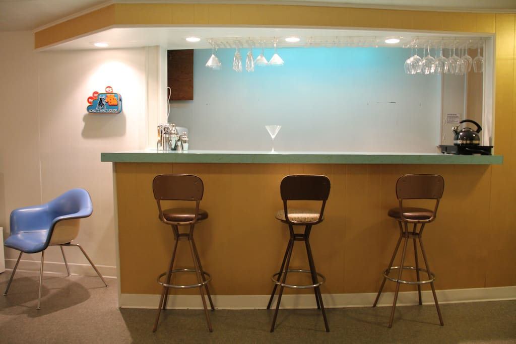 Vintage 1950s barstools at the turquoise bar