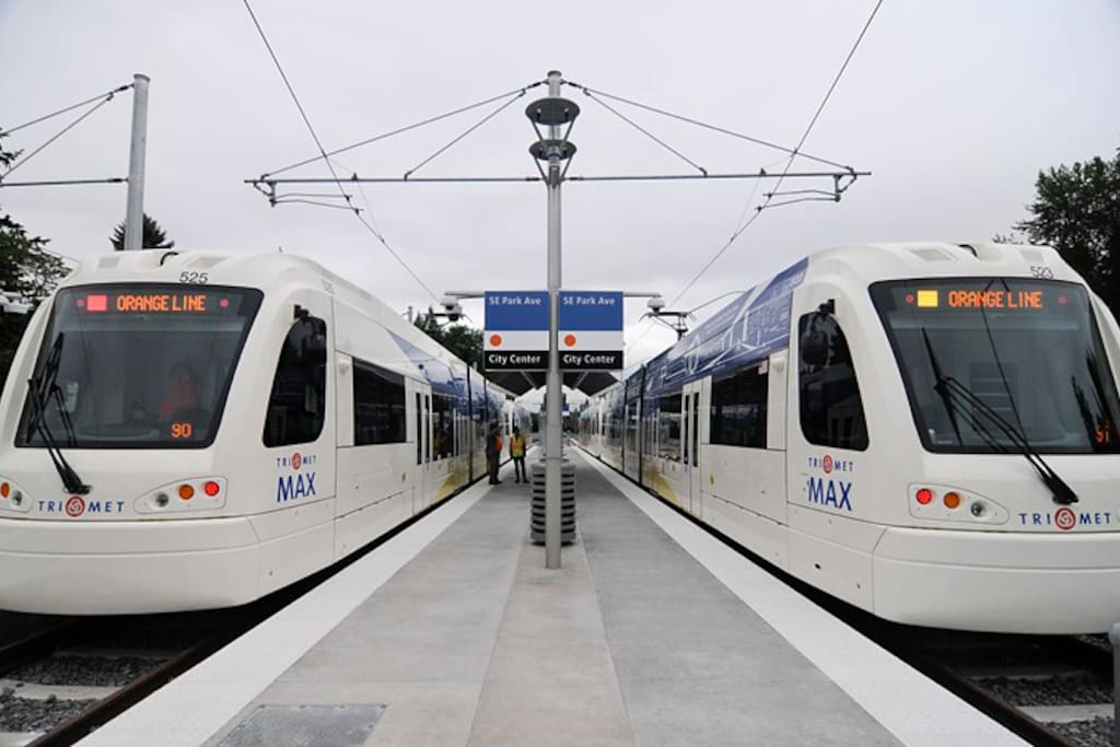 MAX light rail trains with efficient, scenic service to downtown Portland. Nearby station at SE Park Ave. is a 7-minute walk. Travel time is 15 min. to SE Division/Clinton neighborhood, 20 min. to South Waterfront / OHSU, and 25 min. to downtown Portland.