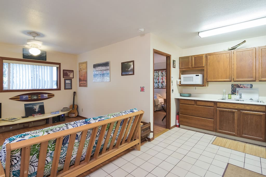 Tile floors in kitchen, enter bedroom