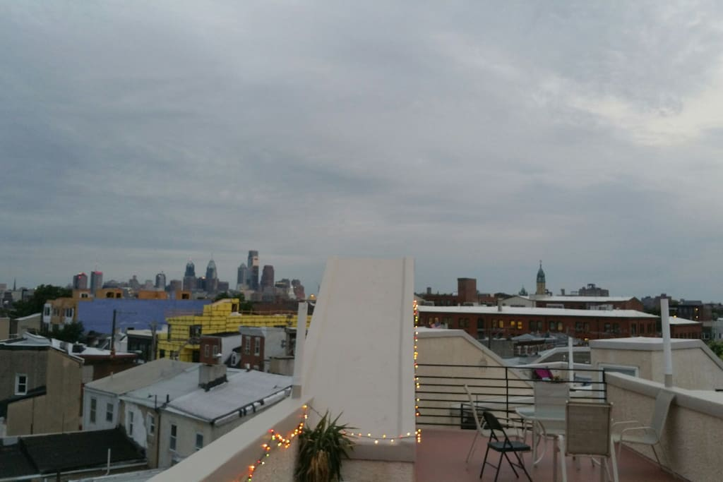 Evening on the roof.  Showing our table that comfortably seats four w/ extra chairs available.