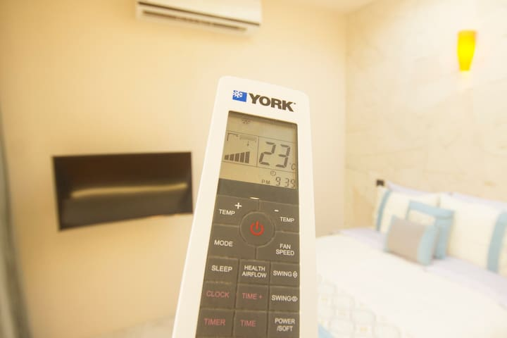 AC - Remote Control Air condition with natural airflow mode.
