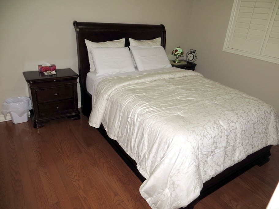 Queen Size bed with two side tables and very comfortable mattress for your comfort and good night sleep. You will find clean fresh spotless bedding when you check in. Keeping place spotless is our passion.