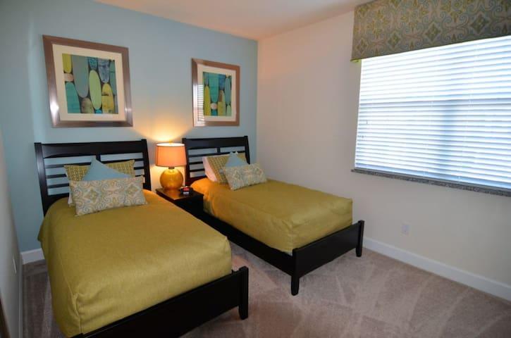 Bedroom 3 is an attractive twin room with en suite bathroom and flat screen TV