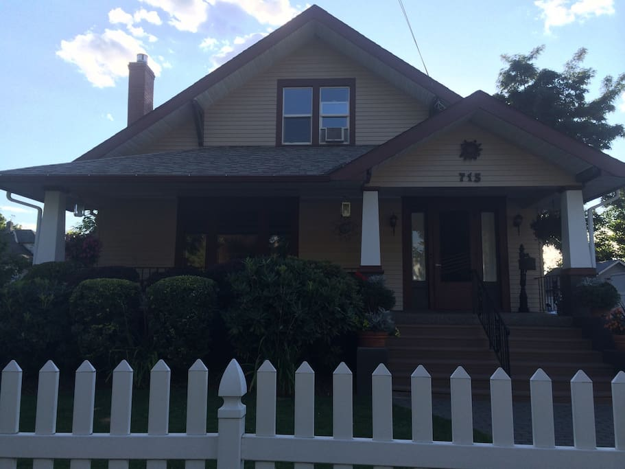 Front of house with fully fenced yard
