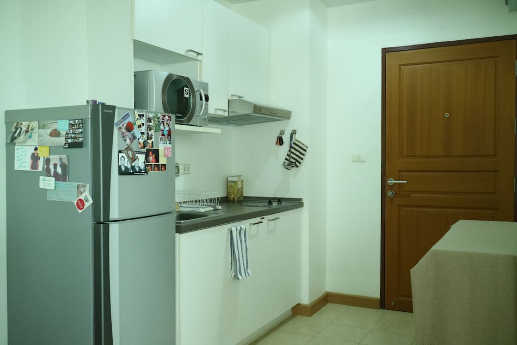 Entrance to a minimal kitchen with essential appliances.