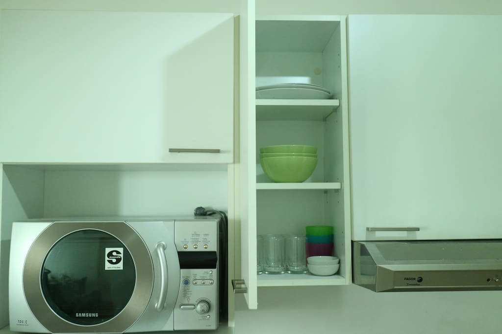 Microwave and kitchen ware.