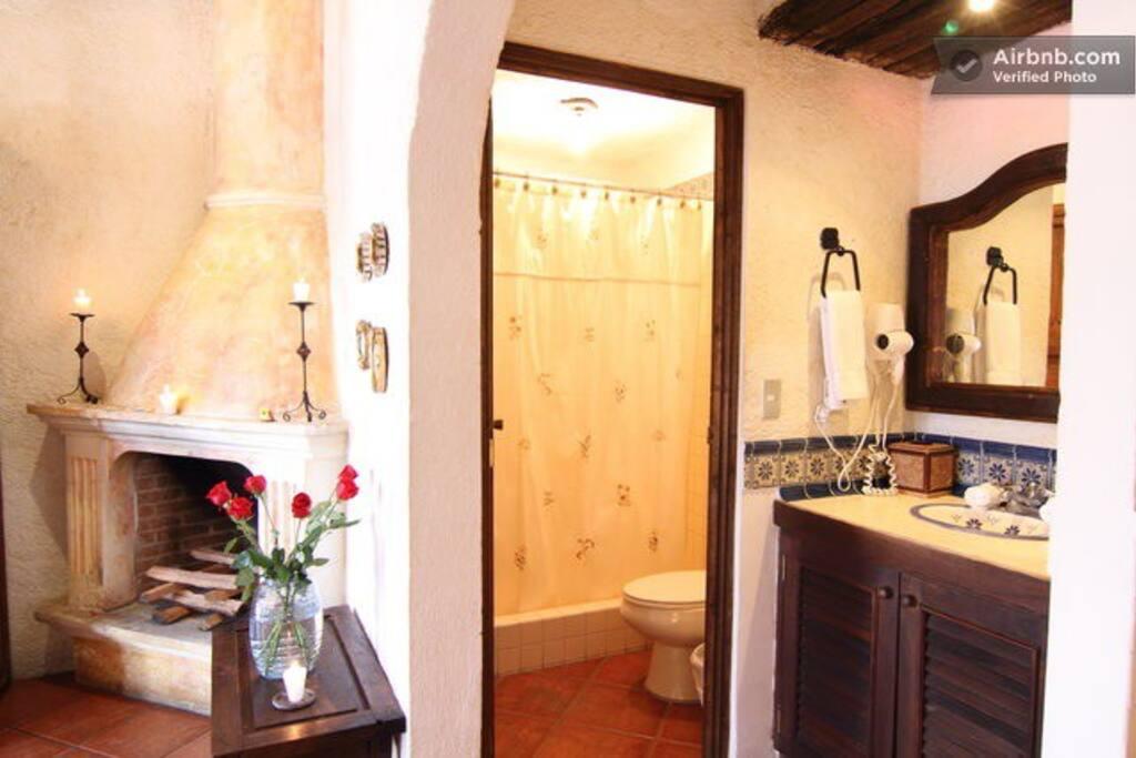 Romantic fireplace, bathroom area