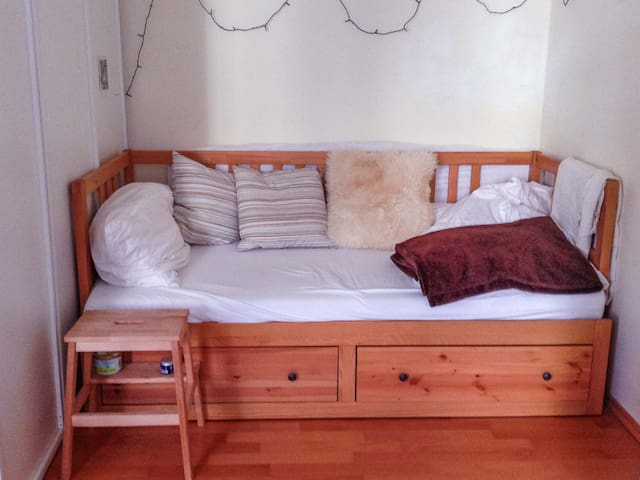 This is the bed. It can be pulled out and made into a double-bed.