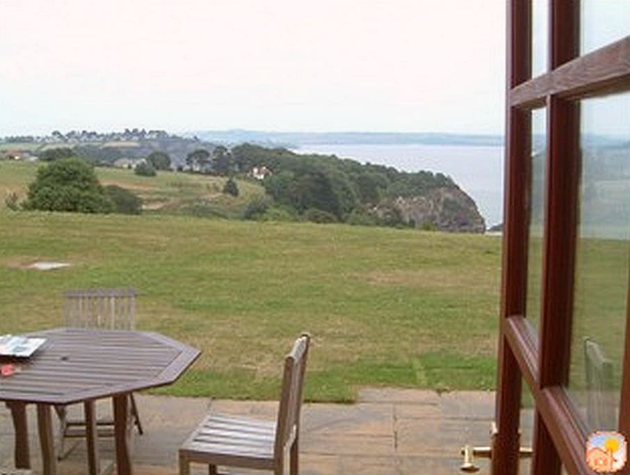 Photo taken through French door at property sowing the great sea view.