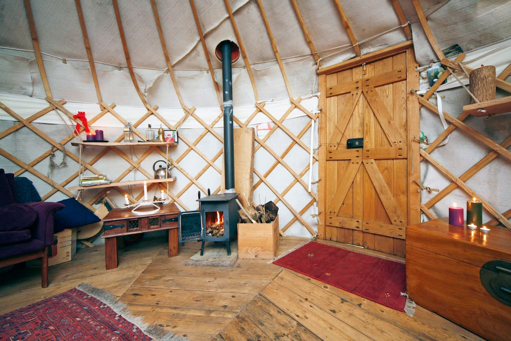 On entering the yurt, visitors must leave their horses outside and remove shoes