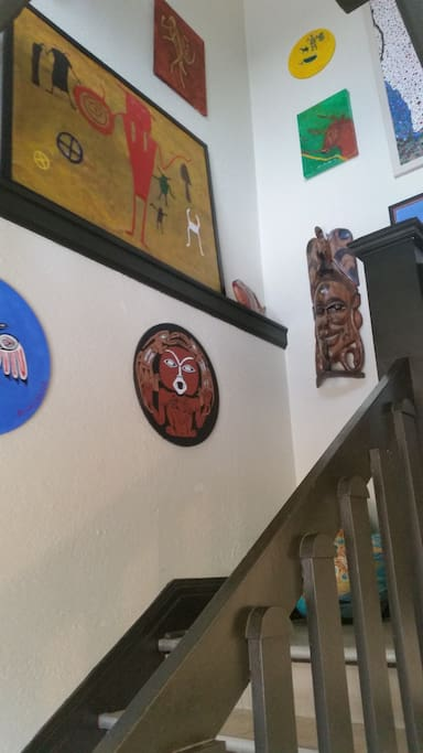 Stairs leading to apartment.  Hand painted Art by one of our long-term tenant.