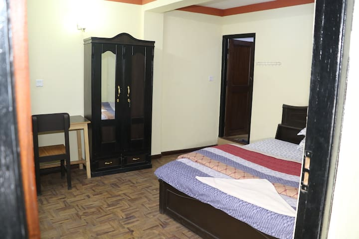 Queen size bed room & bed with  balcony, attached bathroom/toilet.