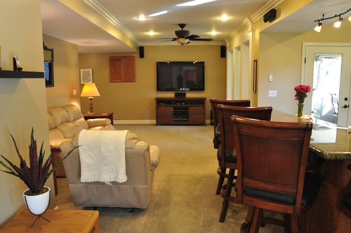 """Main living area with a 63"""" TV and surround sound system"""