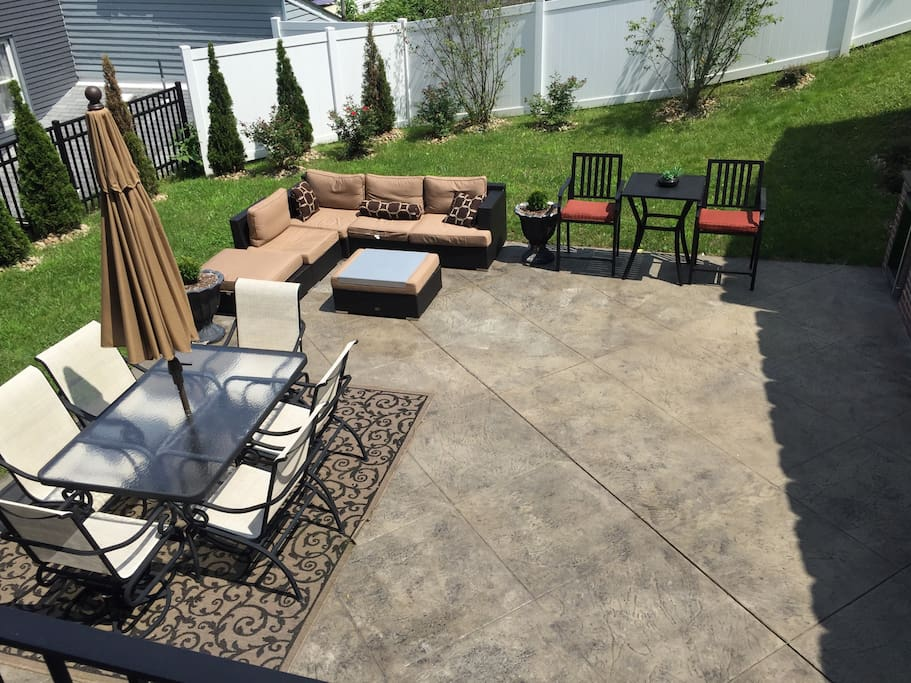 Outdoor patio space that is shared with the other tenants. Great place for morning coffee or to grill out on the gas grill!
