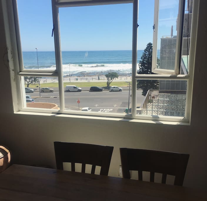 Watch people run and cycle on the Sea Point promonade while eating breakfast