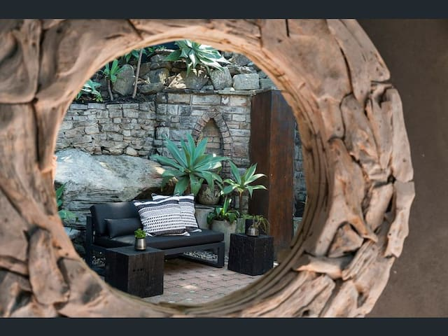 Gorgeous statement driftwood mirror at the front door entrance