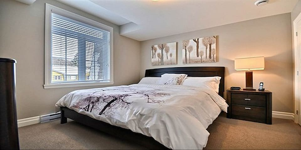 The master bedroom with a comfortable king size bed and ensuite bathroom.