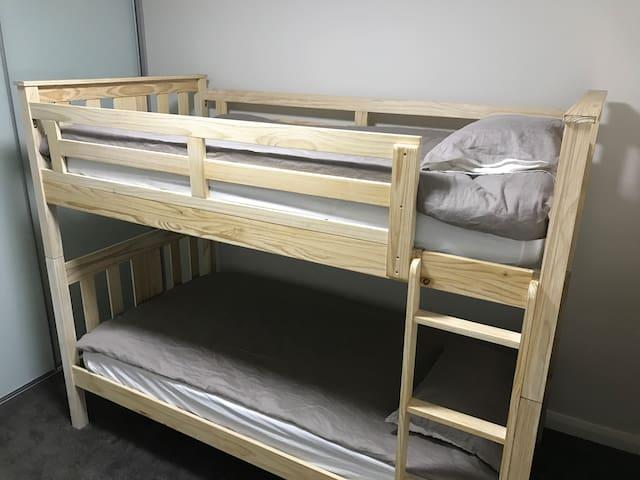 Bedroom 3 and built in wardrobe.