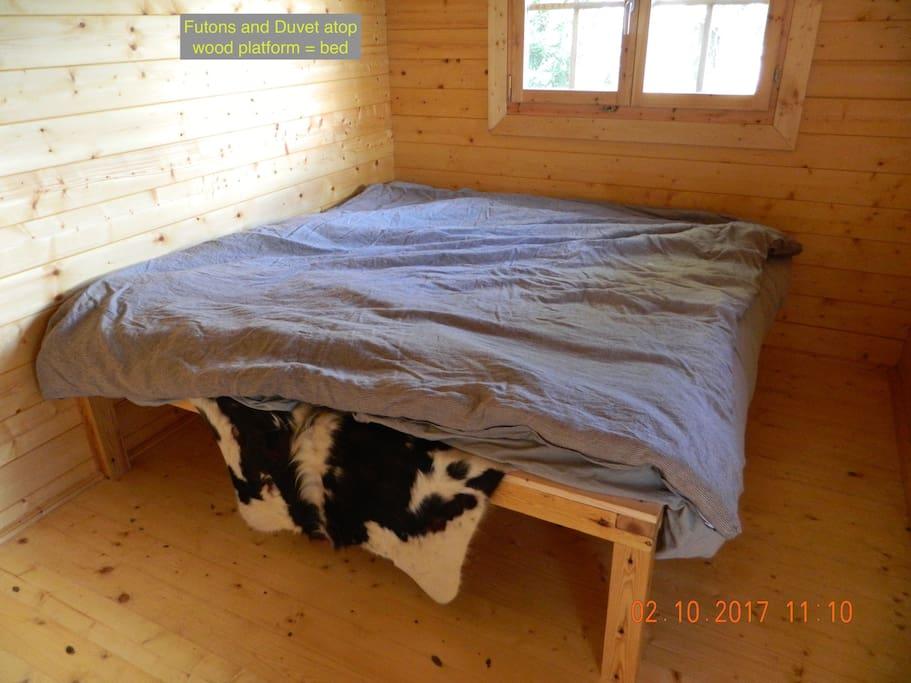 Japanese futons on wood platform bed