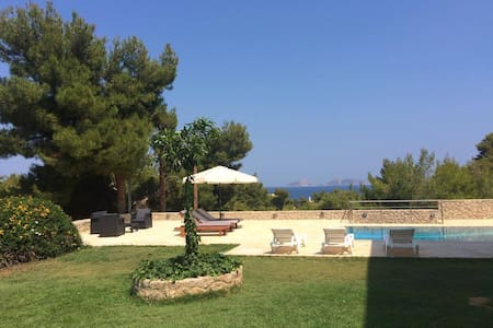 Holiday sea view apartment with garden and pool