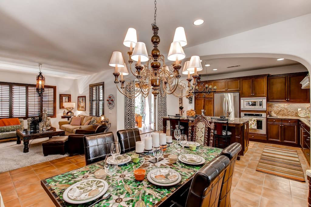 Spend time with loved ones at this darling dining room table with ample seating.