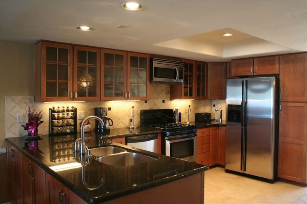 Updated kitchen with granite counters and Travertine Floors