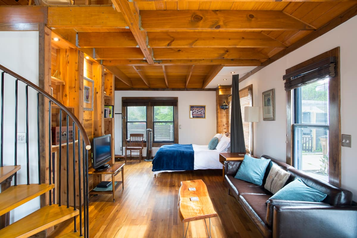 Modern, Lofted Cottage with Custom Woodwork in Central Atx