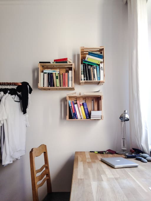 Spacious working area with oaken study desk and self-made bookshelves