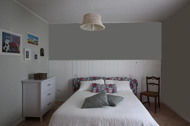 camera matrimoniale piano superiore con aria condizionata( upper floor room with air conditioning)