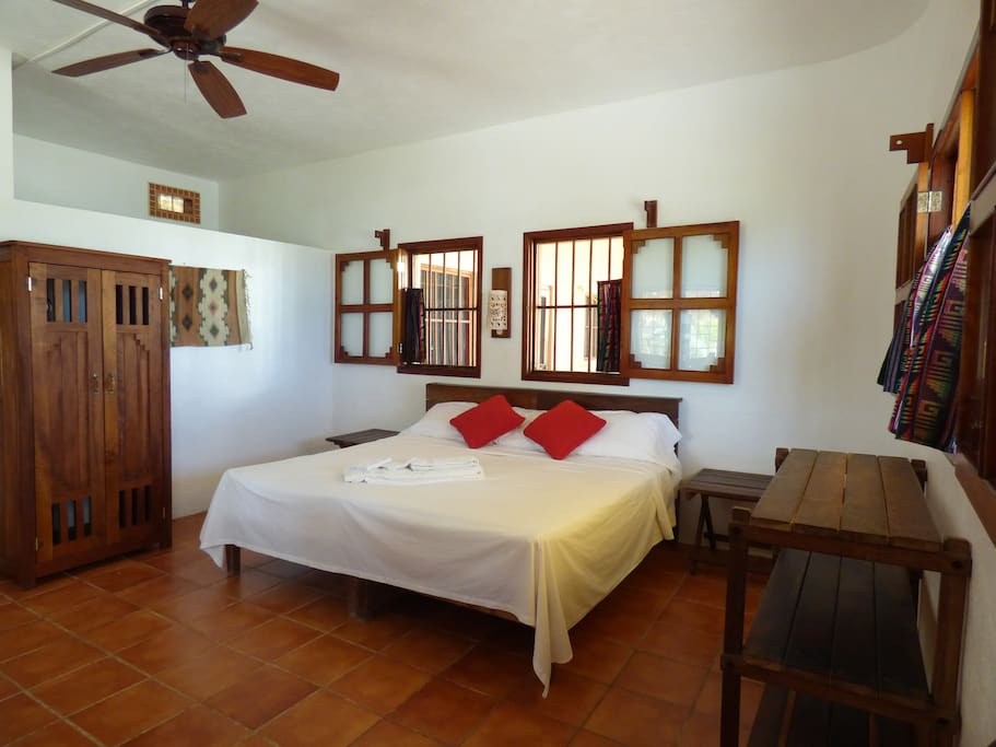 Large King sized bed that can be made into two singles.  Windows that open to the Caribbean trade-winds keep the room cool.