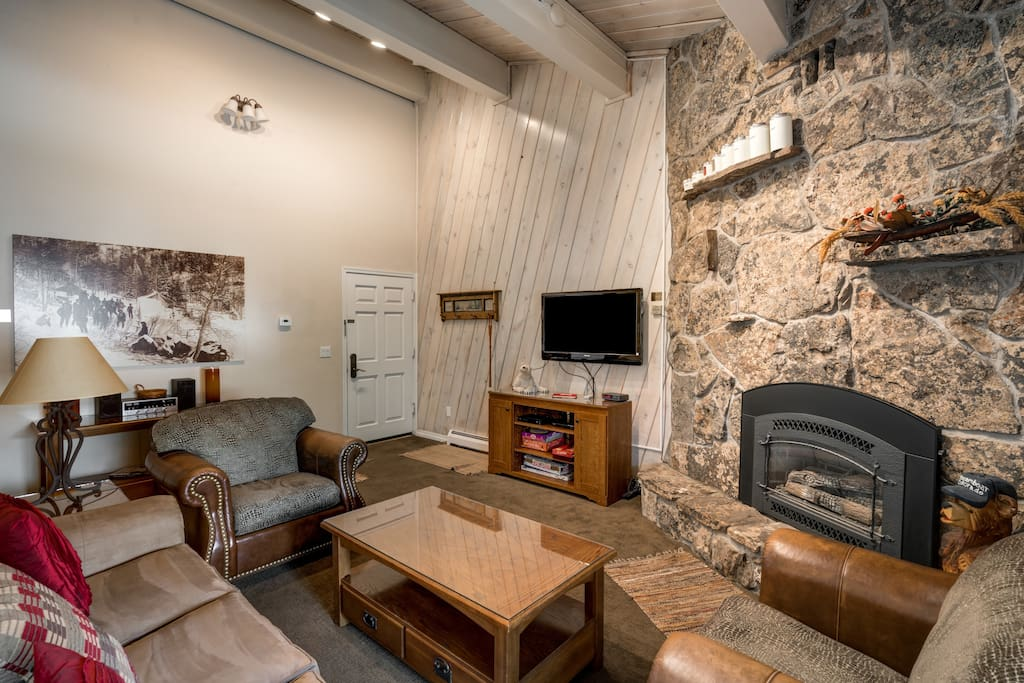 There's seating for five and a stone fireplace in the inviting sitting area.