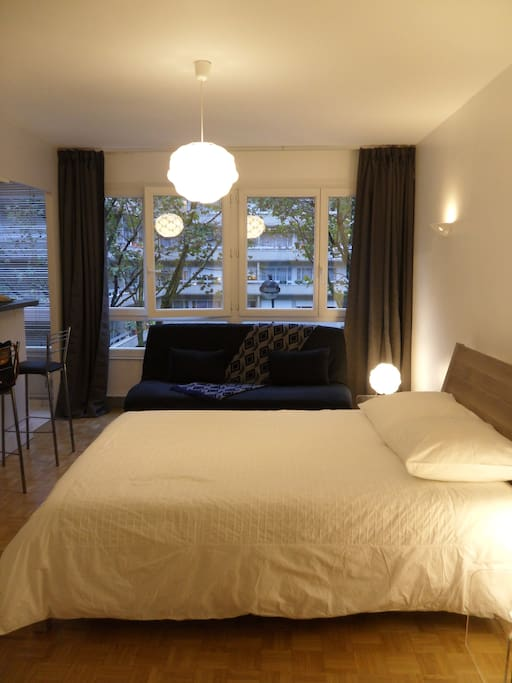 Apartment features a queen-size bed with clean, comfortable linens, duvet, and pillows.