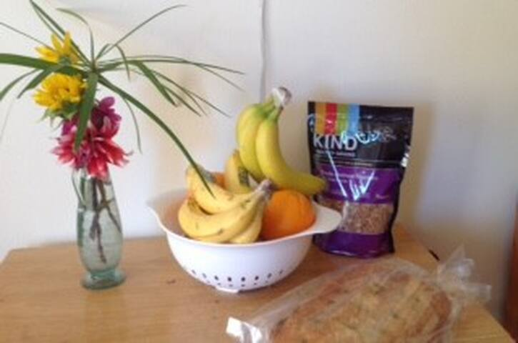 Fruit and flowers offered to our guests/granola