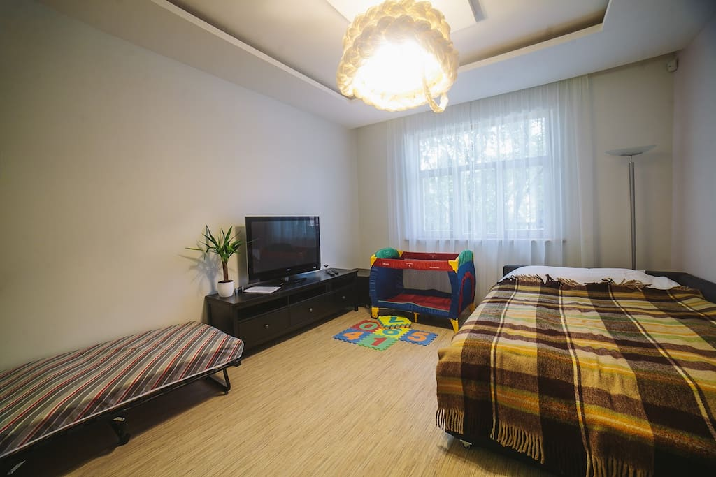 Living room with extra bed and baby cot (on request)